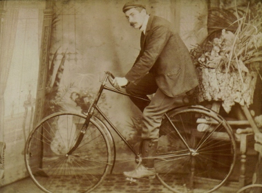 Alfred Henry Buckingham, possibly seated on a Hibbs-Buckingham bicycle (?) c 1900.